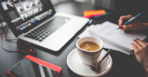 Desk work setup laptop, coffee, notebook