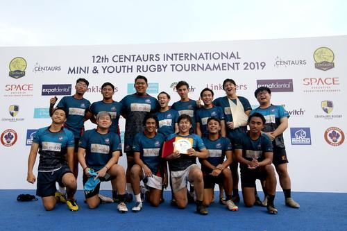 rugby team smiling at camera