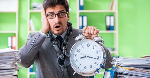 man holding alarm clock