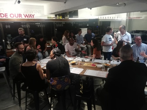 people socialising in wine bar