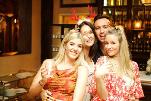 group of people celebrating christmas