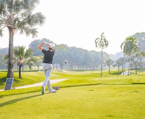 pro golfer hitting shot