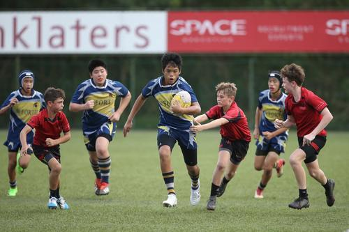 young boys playing rugby