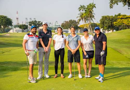 group of golfers smiling at camera