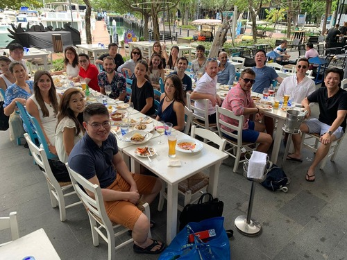 groups of people smiling at camera on 2 large outdoor tables