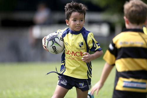 young boy playing rugby