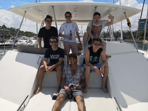 men standing on boat smiling