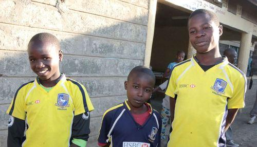 3 young boys looking at camera